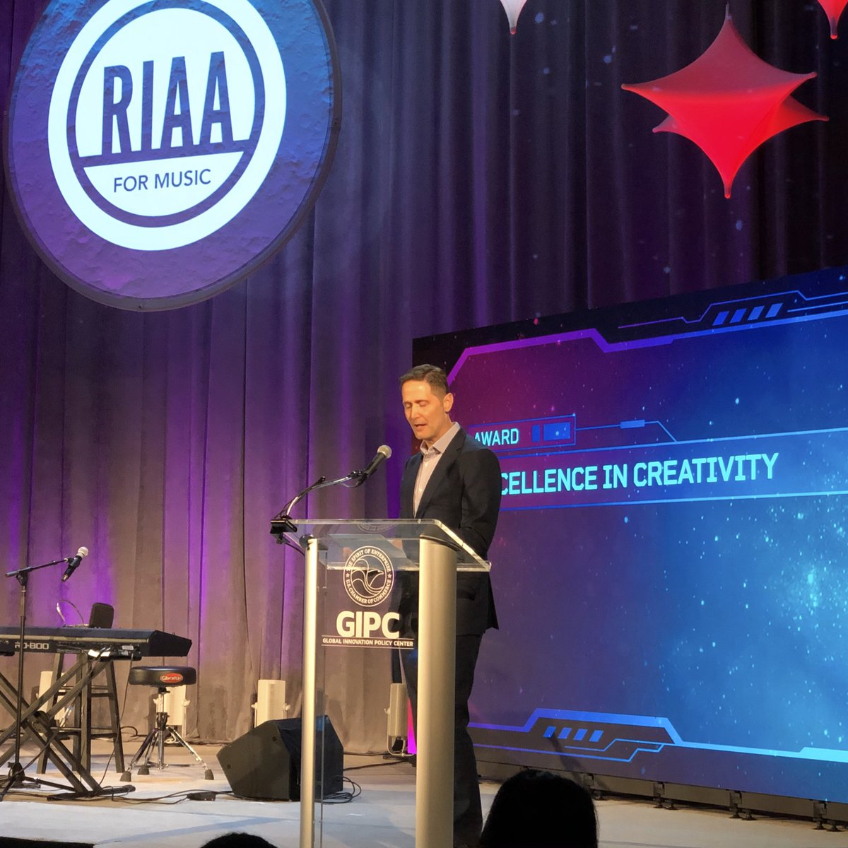 RIAA's Chairman and CEO @mitch_glazier was honored to present the Excellence in Creativity Award to @WMNashville's @janson_chris at the 2019 IP Champions Gala✨ #IPChamps2019