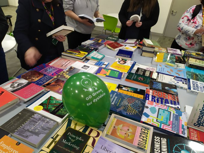 Nessy on Twitter: The @UniofSuffolk #GOGreenfordyslexia with a book sale for charity during #DyslexiaAwarenessMonth! @DrMariannaStell giving students wristbands and green lollies!…