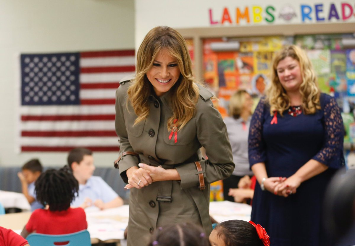 Melania Wows In Stunning Charcoal Grey Trench Coat During South Carolina Trip
