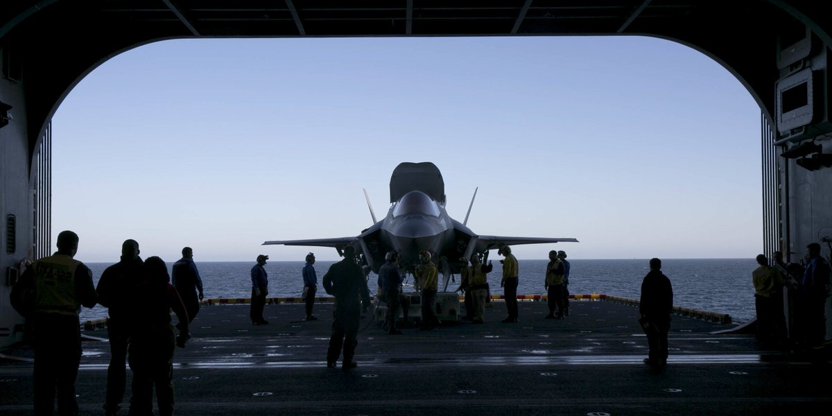 Look What the Tide Rolled In Marines and @USNavy Sailors observe an F-35B Lightning II with Marine Fighter Attack Squadron 122, Marine Aircraft Group 13, @3rdmaw, getting tied down prior to being transported to the flight deck aboard the amphibious assault ship USS America.