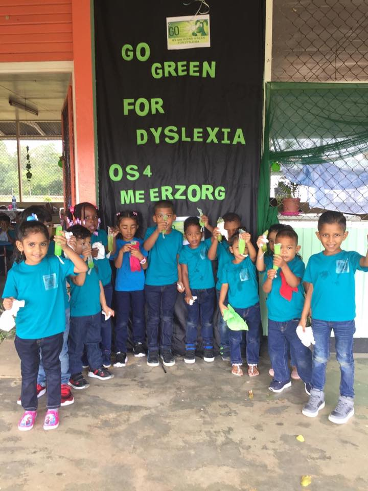 Nessy on Twitter: Class O.S.4 Meerzorg in Suriname #GOGreenfordyslexia and celebrate with green balloons and ice lollies! We think Natatsia Regina and staff look great in #green…