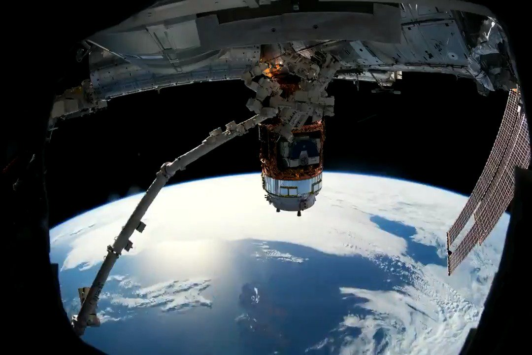 Gone but not forgotten! Watching the HTV cargo ship depart @Space_Station today and remembering the complex dance of the robotic arm that marked the beginning of its stay. The batteries being removed were later installed by us on spacewalks—can't beat that for teamwork!