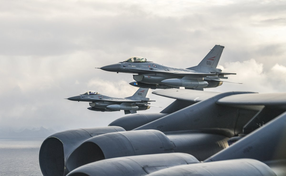 Royal Norwegian Air Force F-16s assigned to the 331st Squadron, Bodø Air Force Base, Norway, fly next to a @usairforce B-52H Stratofortress during training in support of Bomber Task Force Europe 20-1, Oct. 30, 2019, in Norwegian airspace. (Photo by Tech. Sgt. Christopher Ruano)