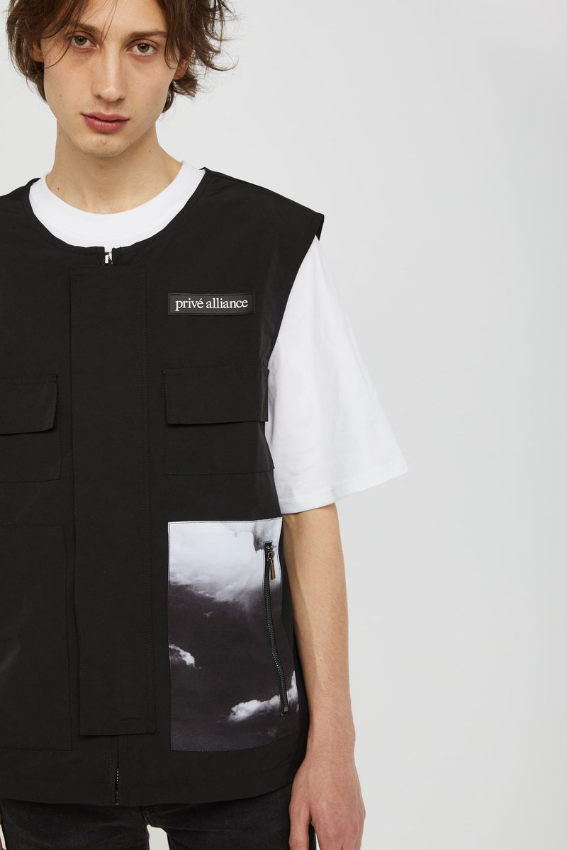 """@B_hundred_Hyun thought of adding a new silhouette to our collections—a utility vest. """"DEPARTURE"""" in polyester material with digitally printed graphic available now at privealliance.com"""