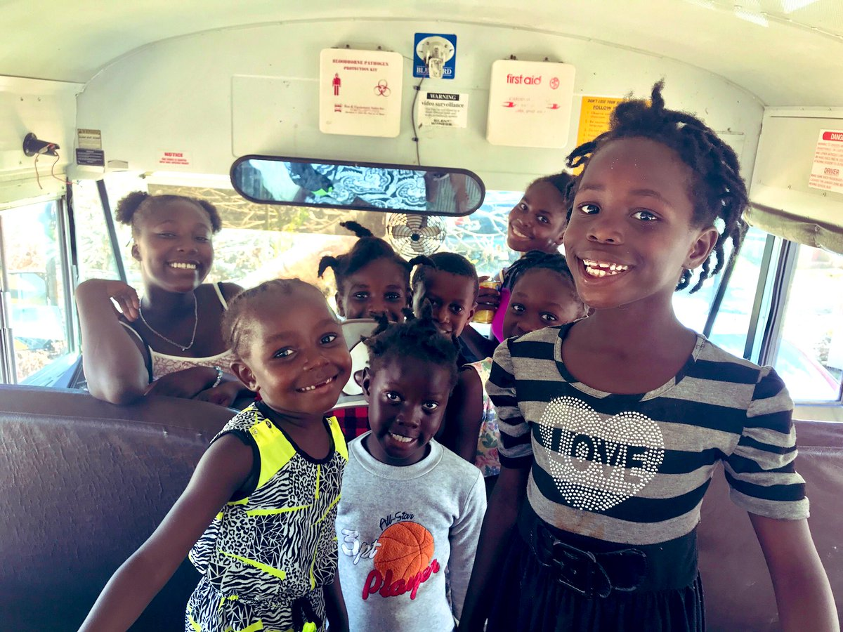 These kids lived on this school bus for days after #HurricaneDorain & and lost everything they own. Yet they are all smiles. That's #MondayMotivation for us! #BahamasStrong
