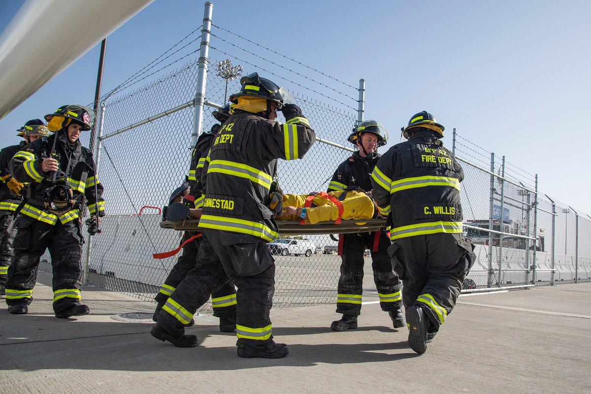Emergencies can happen in confined spaces and it's up to responders to be ready for the challenge. • Fire Department responders carry out a mannequin to an emergency vehicle as part of an emergency exercise. • More: go.nasa.gov/2pEhxov