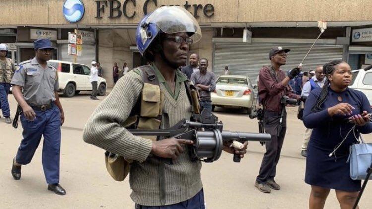 Riot police zimbabwe