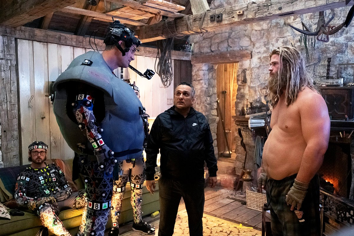 This newly-released photo from behind-the-scenes of #AvengersEndgame features @MarkRuffalo in a Hulk mo-cap suit, @chrishemsworth in a Thor fat suit, and co-director Joe Russo (plus Miek & Korg stand-ins)!