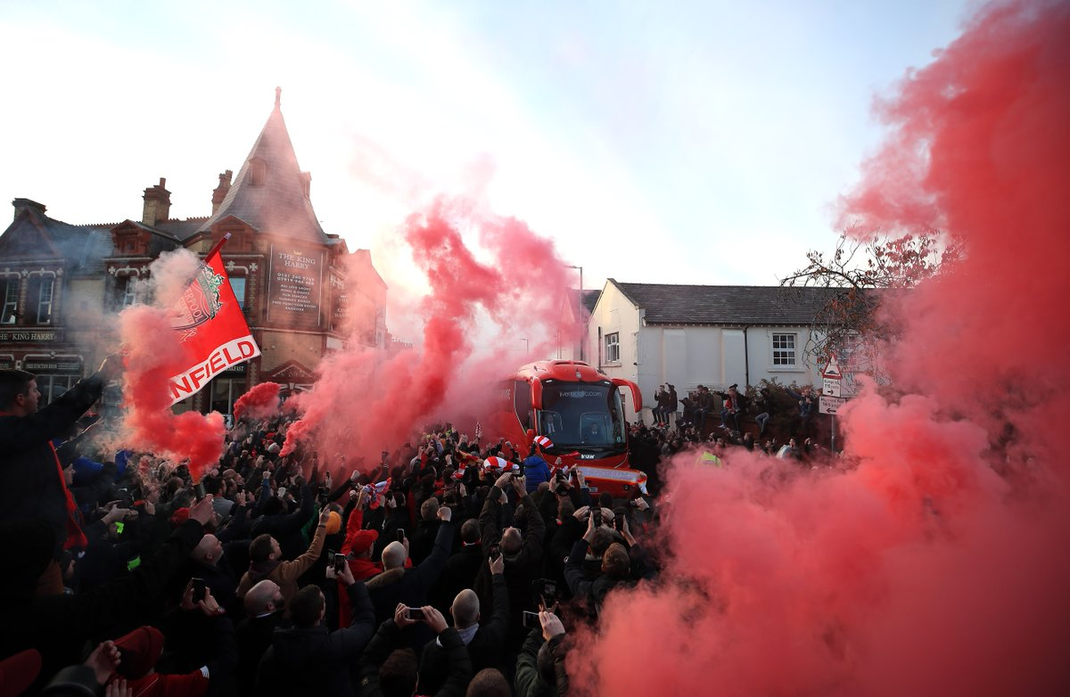 A smokey reception for Liverpool on their approach to Anfield. 🔥