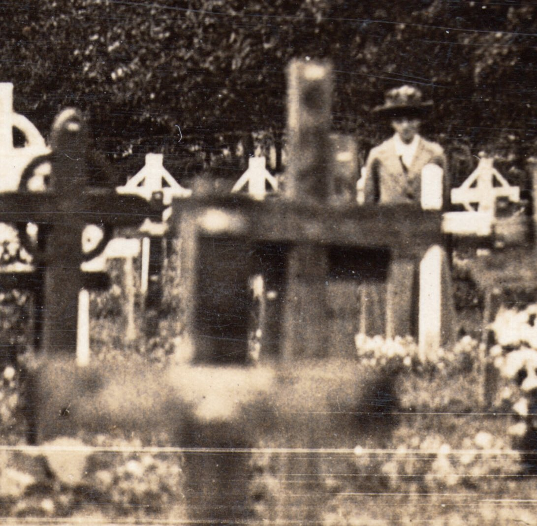 A lone woman looks out from beneath a sea of wooden crosses in a #WW1 cemetery in Flanders. Who was she remembering? These women were as much victims of the Great War as the men they had lost. Lest We Forget. #ArmisticeDay