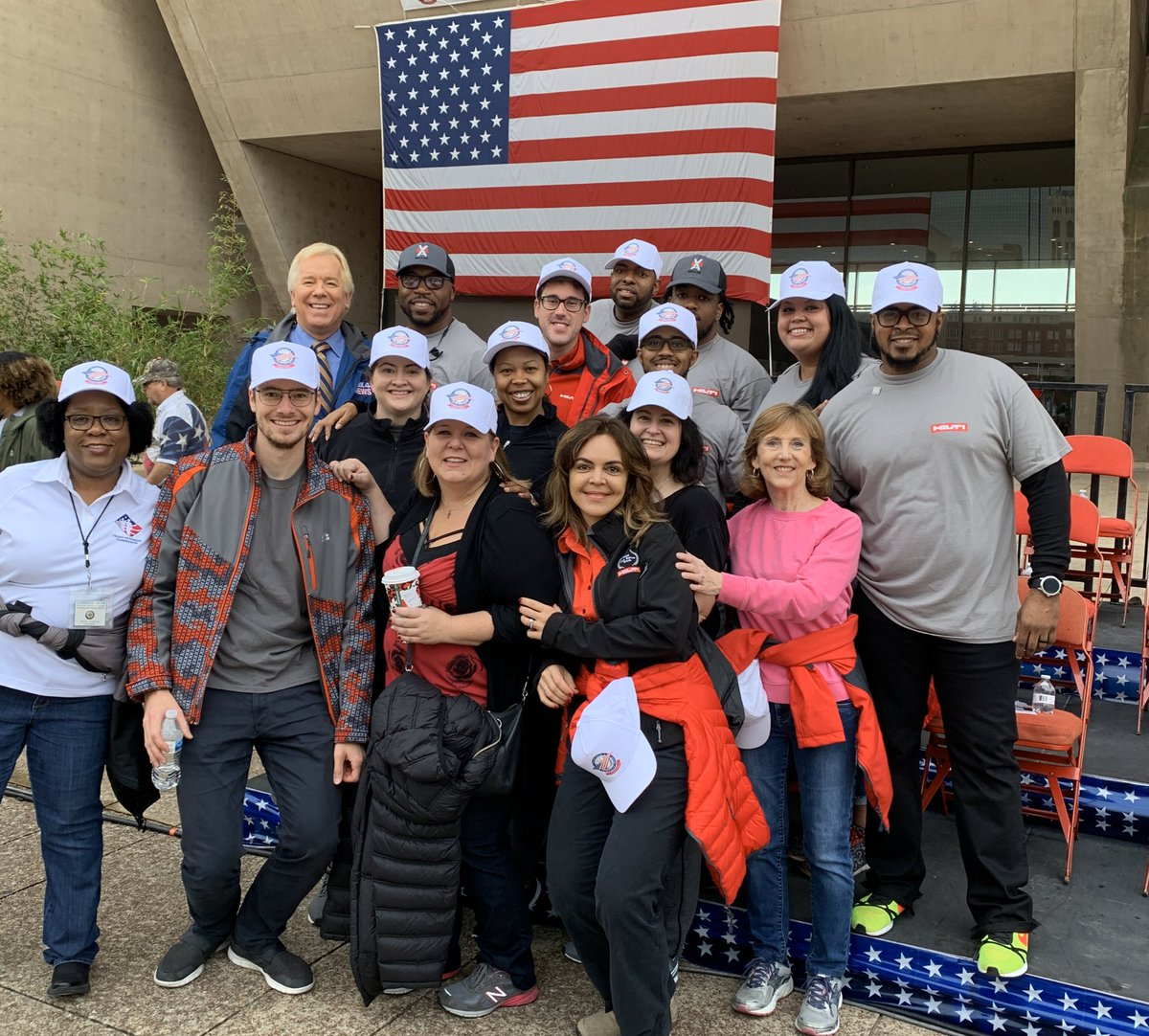 Reporting live this morning, on Dallas' Veterans Day activities. Below are the volunteers from Hilti, a construction services company. They're helping with with set-up. Parade starts at 11:10 am. Be sure to bring a jacket; Temps will be dropping around parade time.