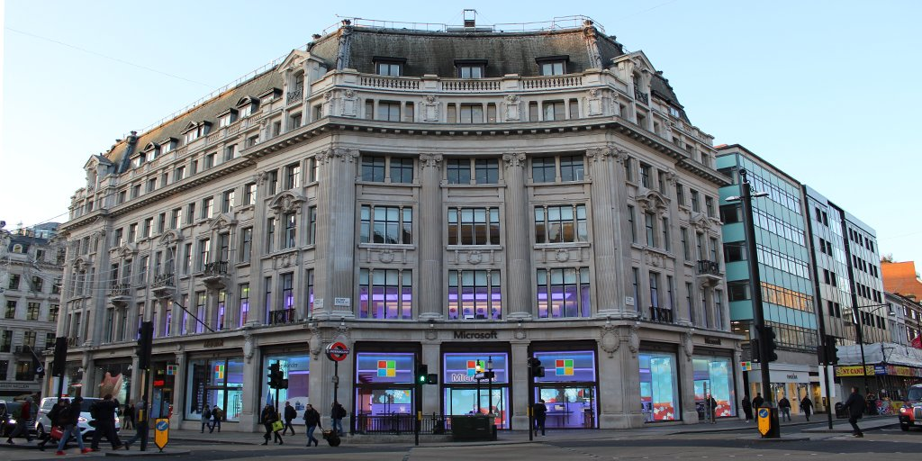 Photograph of London Microsoft store in the daylight with a soft purple illumination to celebrate the company's accessibility day, Purple Tuesday.