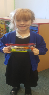 Our KS1 winner who won a prize for the 'Stand Out and be Seen' day for the brightest dressed.