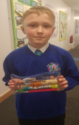 Our KS2 winner who won a prize for the 'Stand Out and be Seen' day for the brightest dressed.