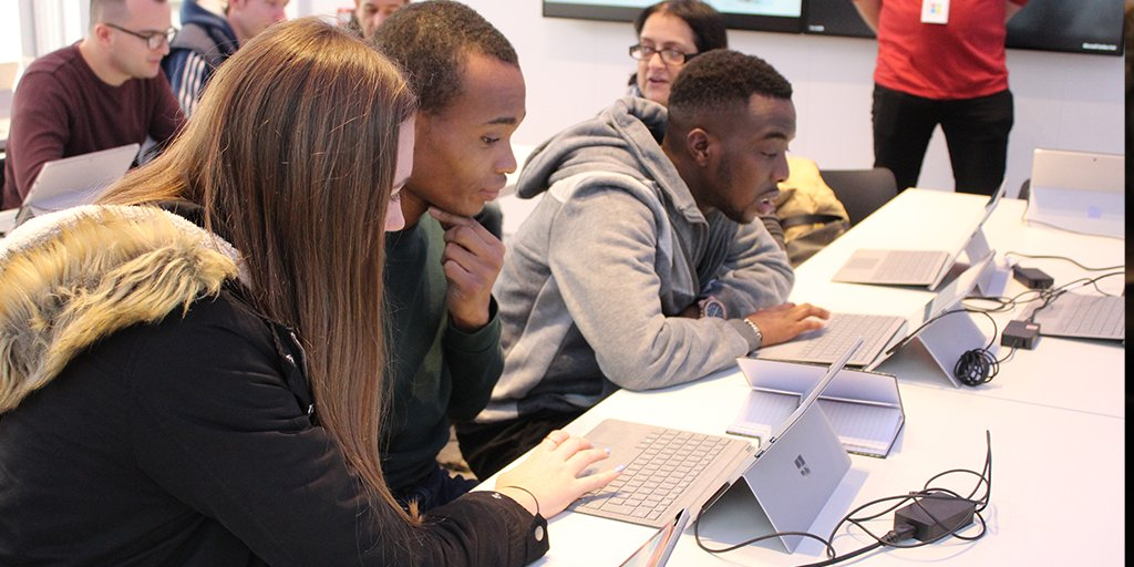Students who are affected by dyslexia participating in a Microsoft accessibility tools session using Surface devices at the Purple Tuesday event held in Microsoft's London Store.