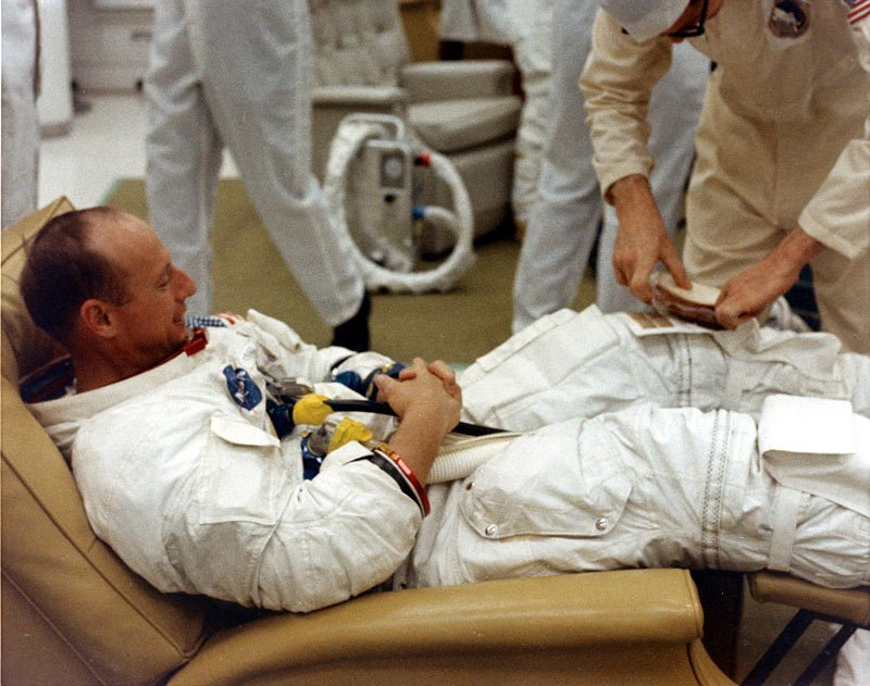 Tomorrow is the 50th anniversary of the launch of #Apollo12! For the long journey, the astronauts needed some sustenance, so here's a suit tech putting a sandwich in Pete Conrad's pocket during suit-up for launch.