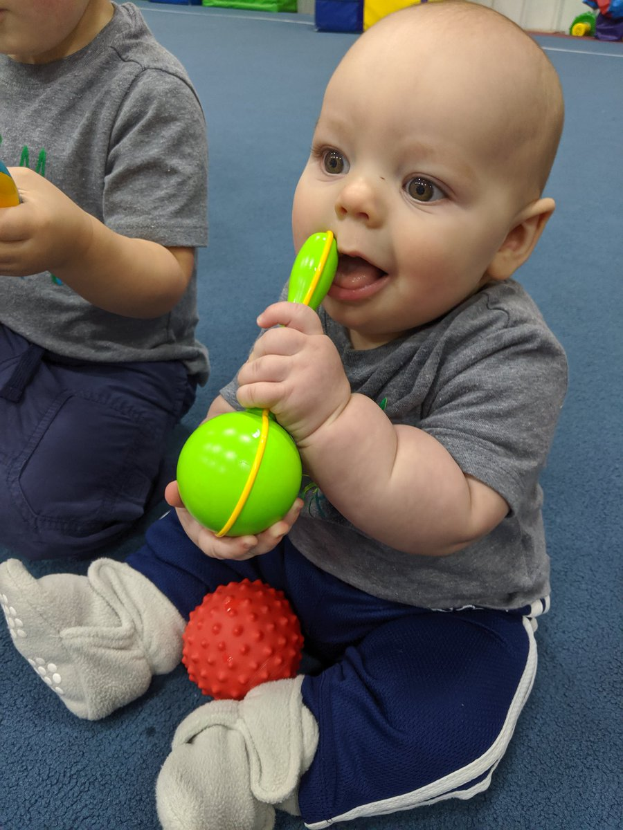 Mommy and me class at #ohiosportsacademy my little playing the maracas or eating it #teething #boysmom #lovemyfamily