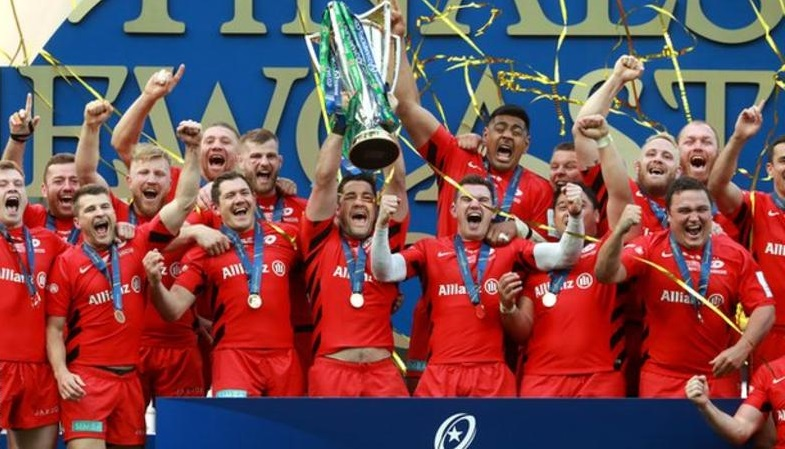 test Twitter Media - All eyes are on Saracens as they begin their European Champions Cup defence under a cloud.  Can they win the title for the fourth time in five years? And who else could challenge for Europe's elite trophy?  All you need to know about the Champions Cup 👇 https://t.co/rqxzIUoAtW https://t.co/gqPIzTHyGr