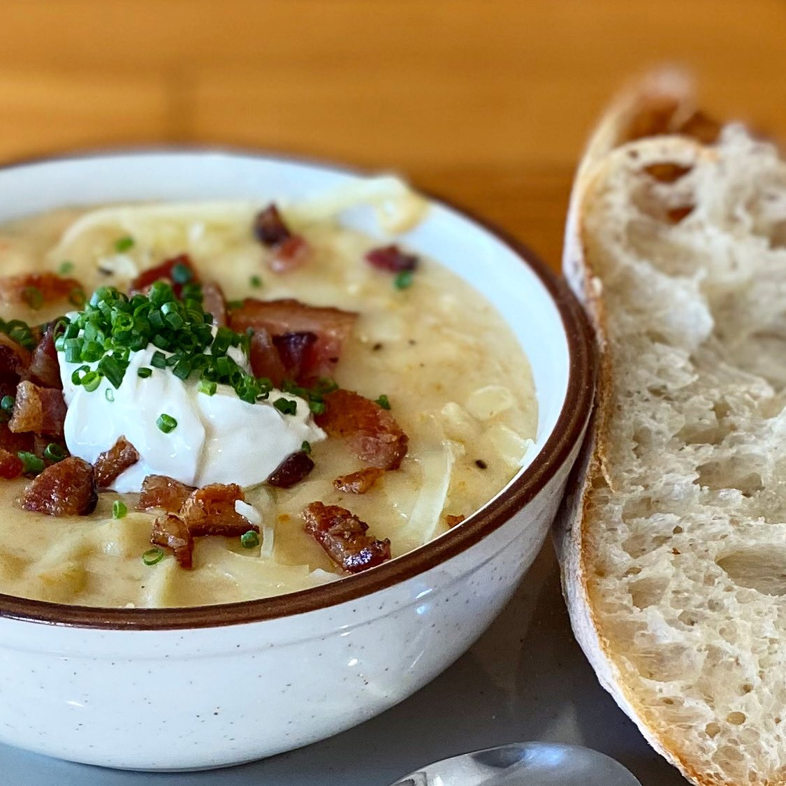 Thick thick thick. Loaded potato chowder with cheddar, bacon, sour cream and chives. Served with a hunk of Wheatfields ciabatta for dunking.