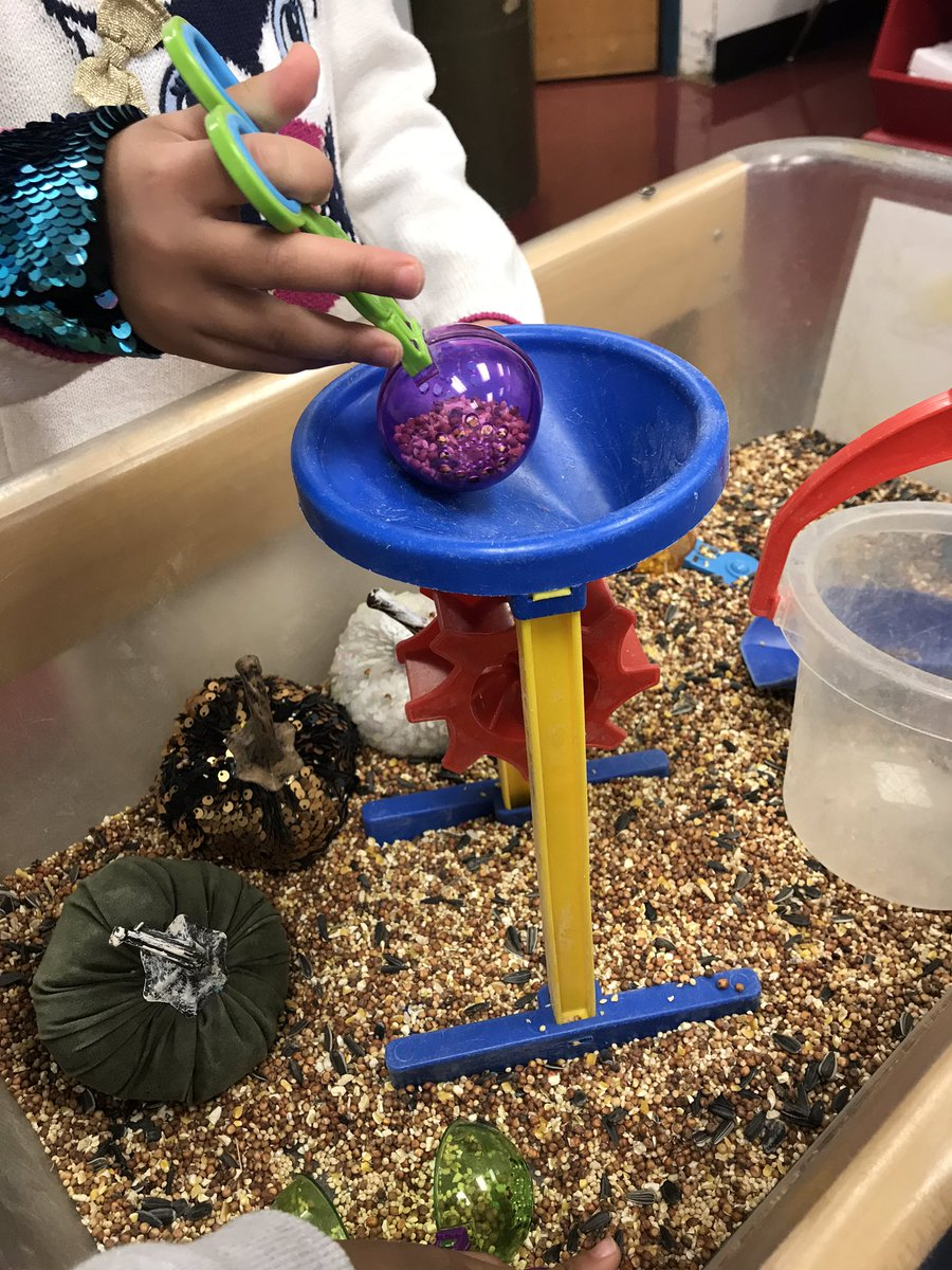 We love our autumn birdseed sensory bin! Our fine motor skills are getting better! <a target='_blank' href='http://search.twitter.com/search?q=kwbpride'><a target='_blank' href='https://twitter.com/hashtag/kwbpride?src=hash'>#kwbpride</a></a> <a target='_blank' href='http://twitter.com/BarrettAPS'>@BarrettAPS</a> <a target='_blank' href='http://twitter.com/APS_EarlyChild'>@APS_EarlyChild</a> <a target='_blank' href='http://twitter.com/APSVirginia'>@APSVirginia</a> <a target='_blank' href='https://t.co/ZiMFBjvUhP'>https://t.co/ZiMFBjvUhP</a>