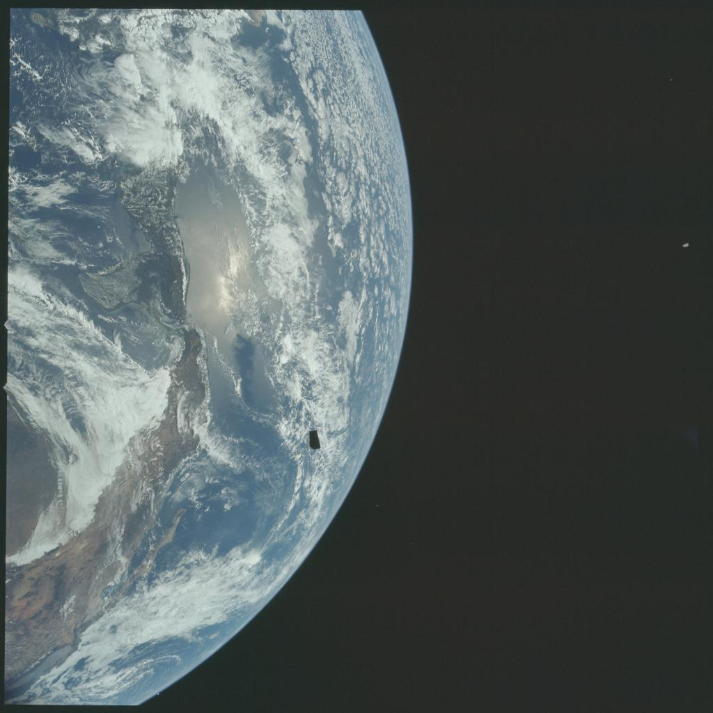 It will take #Apollo12 four days to reach the Moon, with a planned lunar landing on Nov. 19th.   Having completed its Translunar Injection burn and Lunar Module (LM) docking, Apollo 12 jettisoned the LM adapter panels and bid farewell to Earth orbit.  #Apollo50th