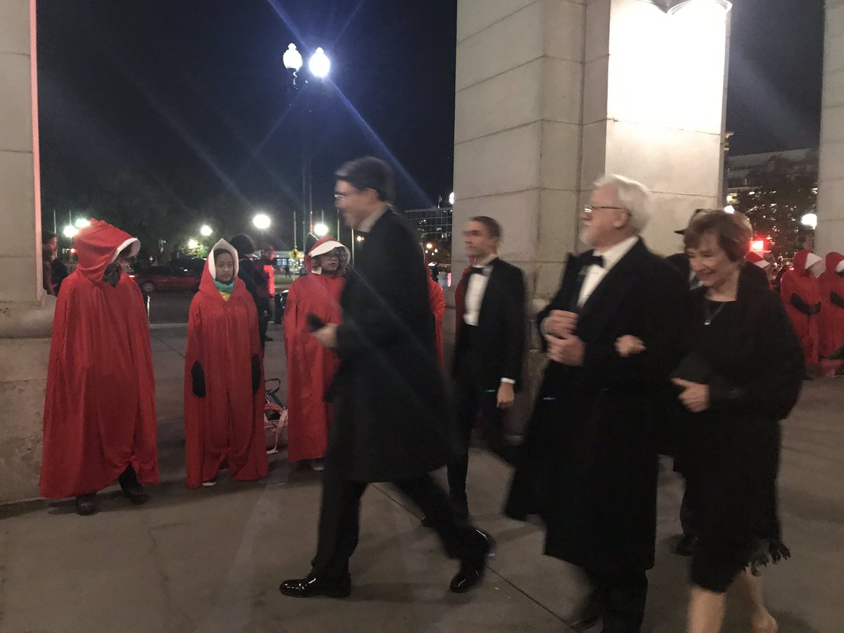 Protesters dressed as handmaids blare Blasey Ford testimony at Kavanaugh dinner…