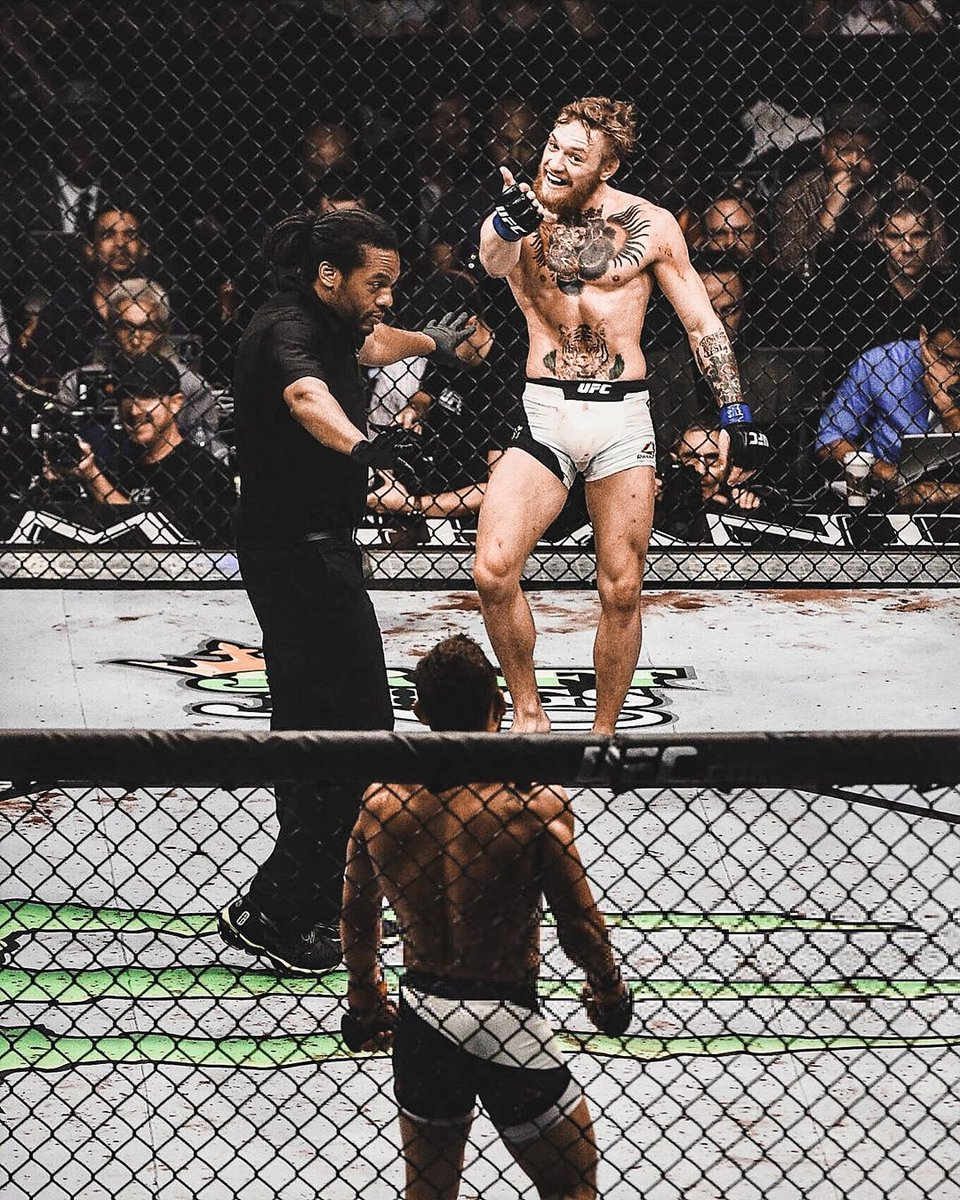 UFC 189 | July 11, 2015  @TheNotoriousMMA and @ChadMendes walkout to live performances by @SineadOconnorHQ and @Aaronlewismusic   Conor McGregor's walkout was dope.   #UFC500 #MMATwitter #UFC246