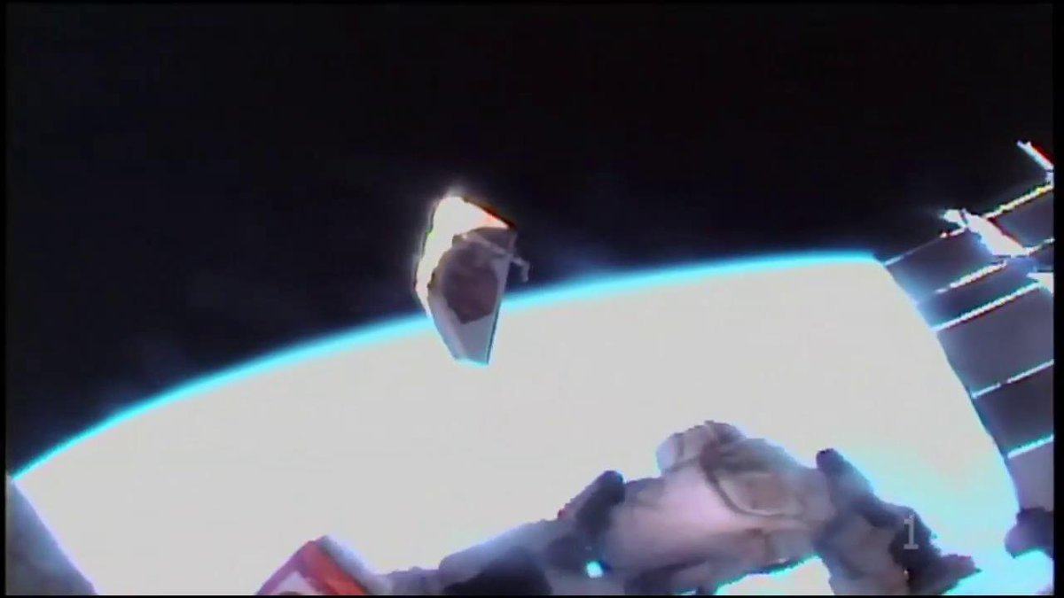 The debris shield that covered Alpha Magnetic Spectrometer floats away towards Earth as @AstroDrewMorgan successfully releases it. #AskNASA | nasa.gov/live