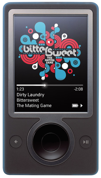 "This week in 2006, the Microsoft Zune was launched. Signature features included a brown color scheme, the ability to ""squirt"" tracks, ear-pieces with magnets and tangle-free cords, and the beginnings of a UI design that continues to this day. Did you have one?  #FlashbackFriday<br>http://pic.twitter.com/EtfqdO6DCm"