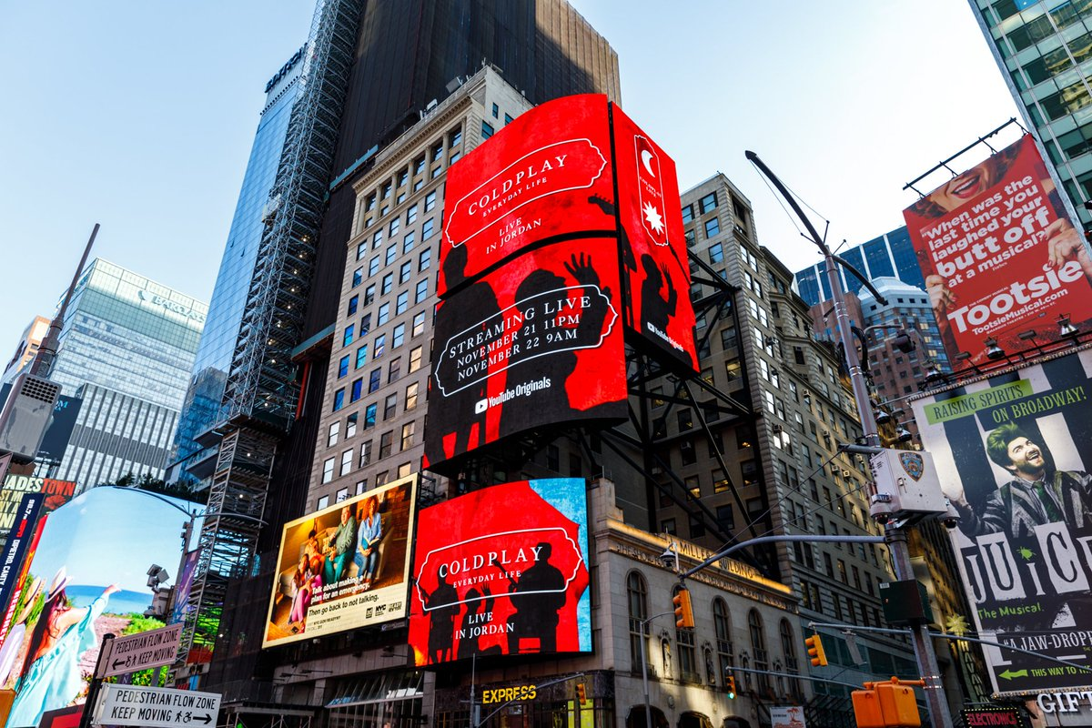 Digital billboards in Times Square NYC celebrating ONE WEEK until the release of #EverydayLife and the bands sunrise / sunset #ColdplayJordan concerts for @YouTube, on November 22. A