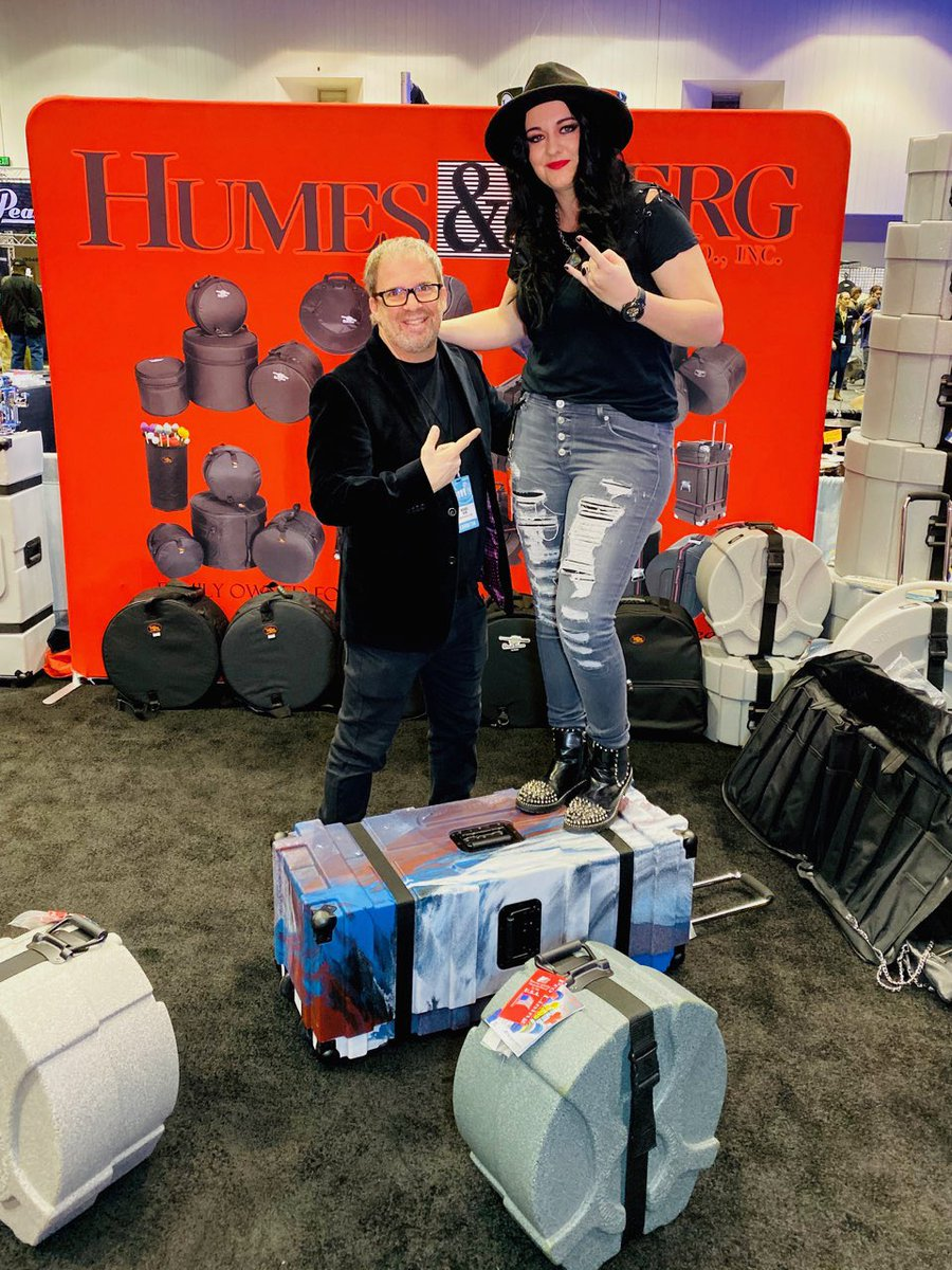 """Our Dir. of Sponsorship & Corp. Relations @michelleEgraves is """"feeling on top of the world"""" @PASIC with one of our incredible #sponsors of #Drummathon2019 Michael Berg with @HumesandBerg! These cases ROCK! 🤘🏻🥁 📸 by: @fotogrldg #PASIC19 #NeverNotWorking #BreastCancerCanStickit"""