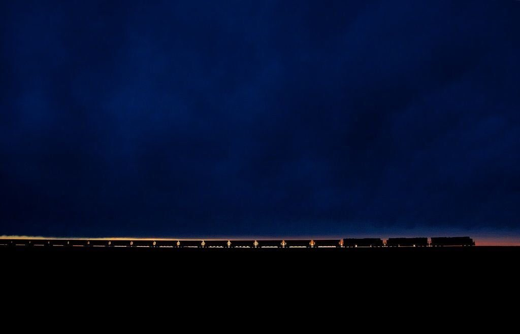 Perfectly timed photo of a BNSF coal train at sunset in Wyoming. (: Tom Danneman) <br>http://pic.twitter.com/5TnnTWvaPN