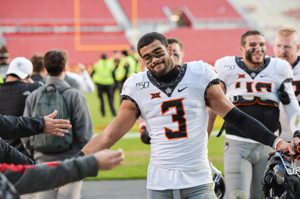 WATCH: OK State's Spencer Sanders with the most awkward hurdle attempt ever  #KANvsOSU #SpencerSanders #SpursUp