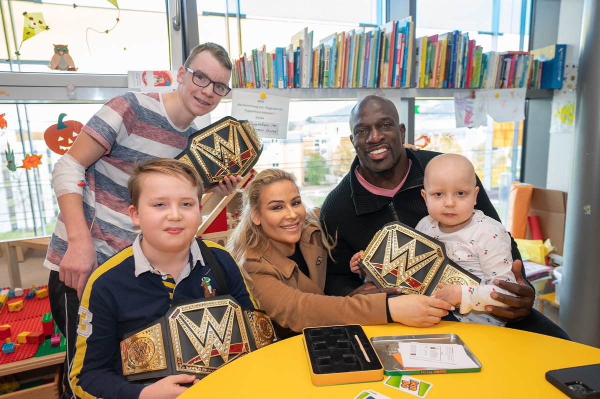 Even while across the world in Germany, @WWE Superstars take time to brighten up the day of sick kids fighting bravely for their lives. Thank you so much @TitusONeilWWE @NatbyNature and @BeckyLynchWWE (not shown here). #KeepOnCrushing #BelieveInTheFight 🎗💛🎗