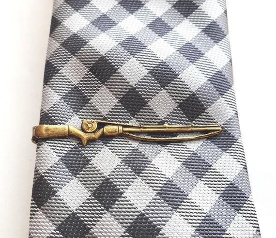 An antiqued gold fishing rod adds a handsome touch and is a perfect gift for a fisherman. #myvintagefancy #Antiqued #Gold #Fishing #FishingRod #Tie #TieClip #FishingPole #TieBar #FathersDay #Rustic #GiftsforMen #Groom #Men #Man #Fisherman