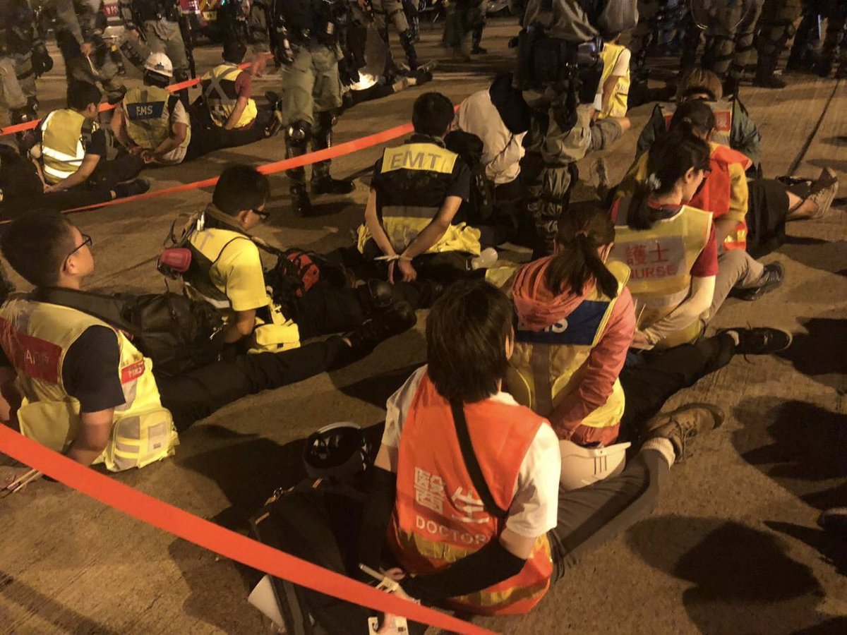 "This photo circulating on Telegram shows first aiders and doctors being mass arrested at the ""safe"" exit.   The Hong Kong Journalists Assoc. is hearing only press with valid credentials can leave. What about student and independent media? https://t.co/Me0F7qV6lr"