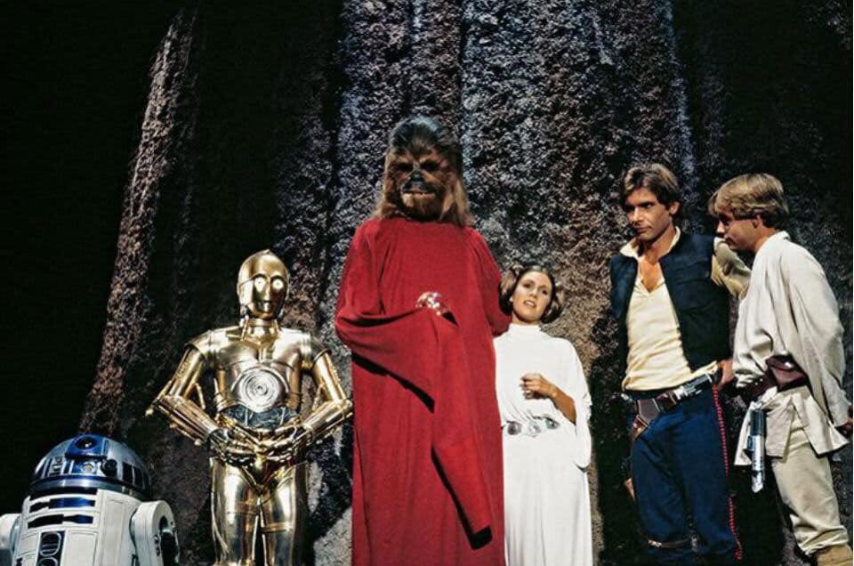 ...JeffersonStarship & circus acrobats, HarveyKorman cooks w/ #Chewie's wife, HanSolo says Chewie's son Lumpy is going thru puberty, Princess Leia sings2 #wookiees in robes holding glowing orbs, & much more weirdness! But it did give us Boba Fett,so there's that. #HappyLifeDay!pic.twitter.com/2bYm88fYGu
