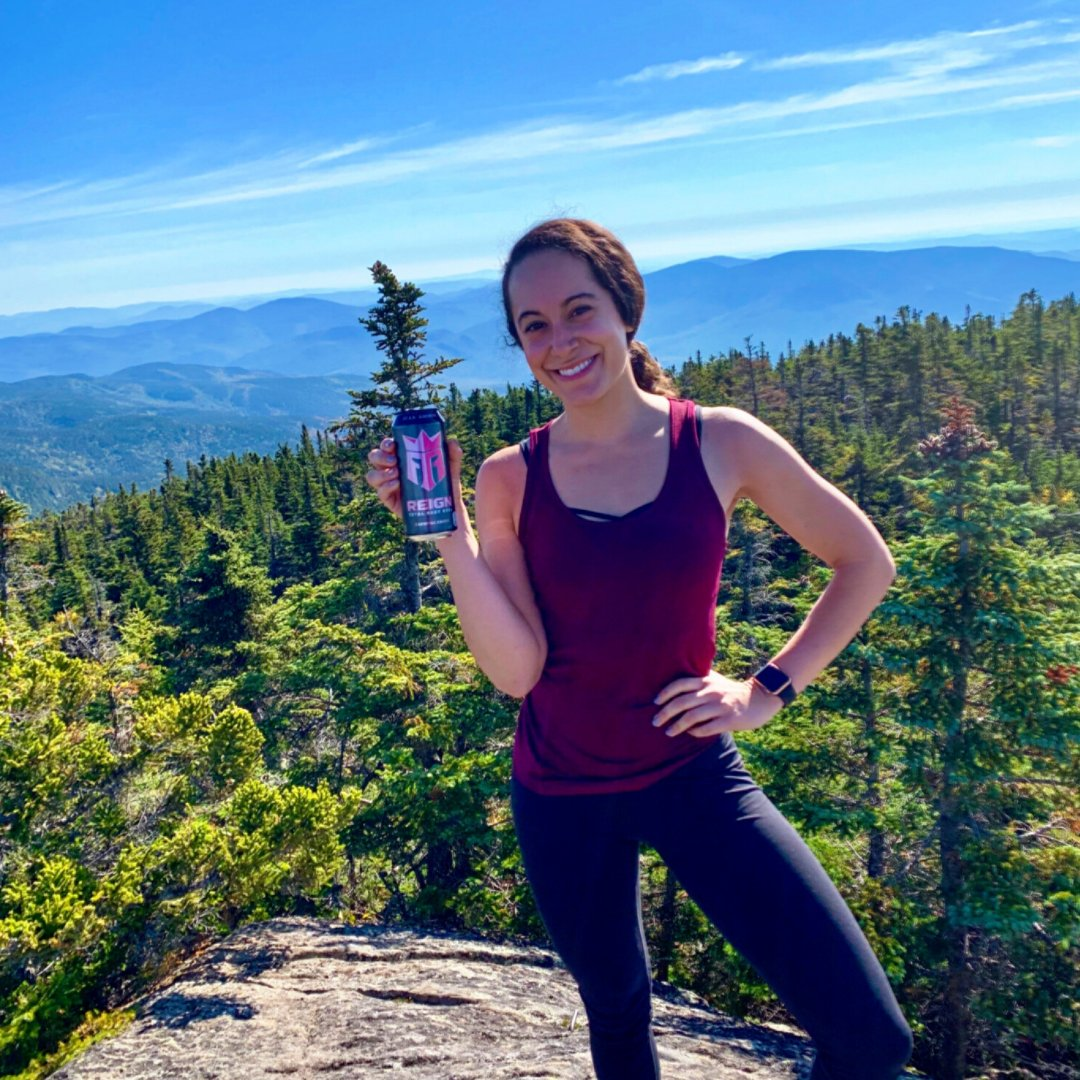 It's #NationalTakeAHikeDay! Our Communications & Community Relations Coordinator, Samantha, fuels up for hiking in the White Mountains with Reign Body Fuel 💪⛰️  Who's taking a hike today?  #CokeNortheast