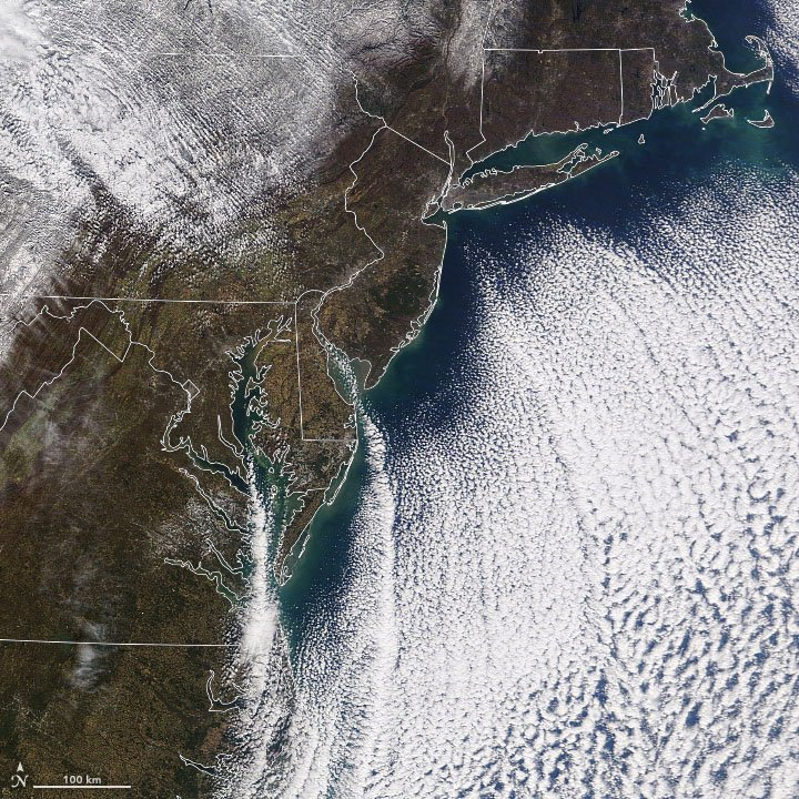 """As a winter-like chill engulfed the eastern U.S. this mid-November, our @NASAEarth satellites captured these """"cloud streets."""" Cloud streets occur when a column of moist air rises and hits a warmer air layer, causing it to roll over on itself. More: https://go.nasa.gov/2q85dgw"""