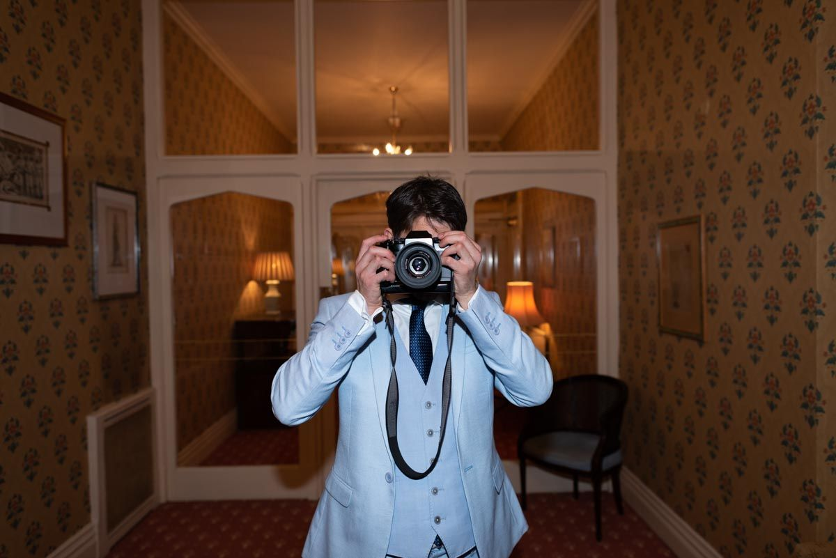Knowing me, knowing you! Michelangelo, a fellow #photographer, reciprocates my gaze at the #WeddingReception of Virginia and Simon in #HorstedHouseHotel, #EastSussex. #weddingphotographer #weddingphotographers #weddingphotographeruk #lewesweddingphotographer #weddingphotography