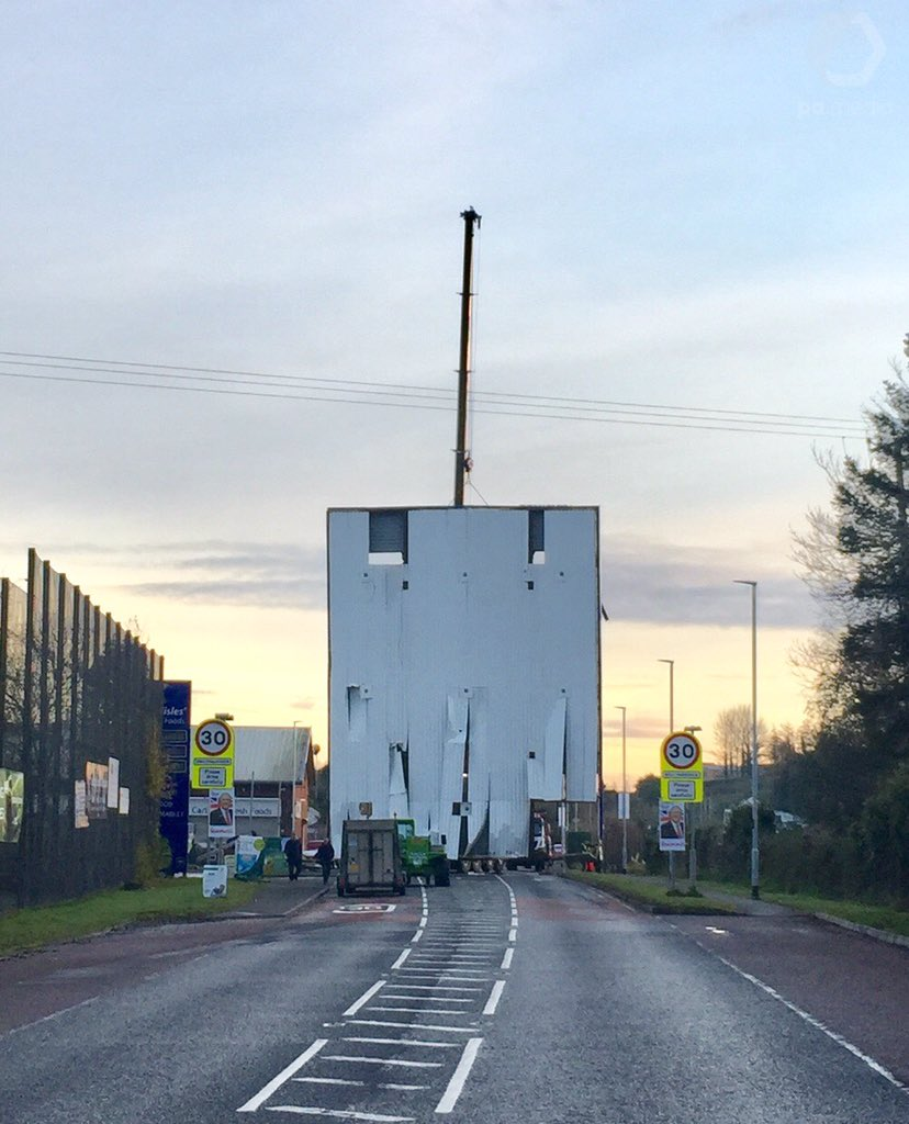 Extraordinary sight in Ballynahinch, Co Down as a petrol station forecourt roof is lifted vertically onto the road by a recovery crane. The damaged roof was knocked down early this morning by ATM raiders who hit it with a digger as they fled the scene. @PA