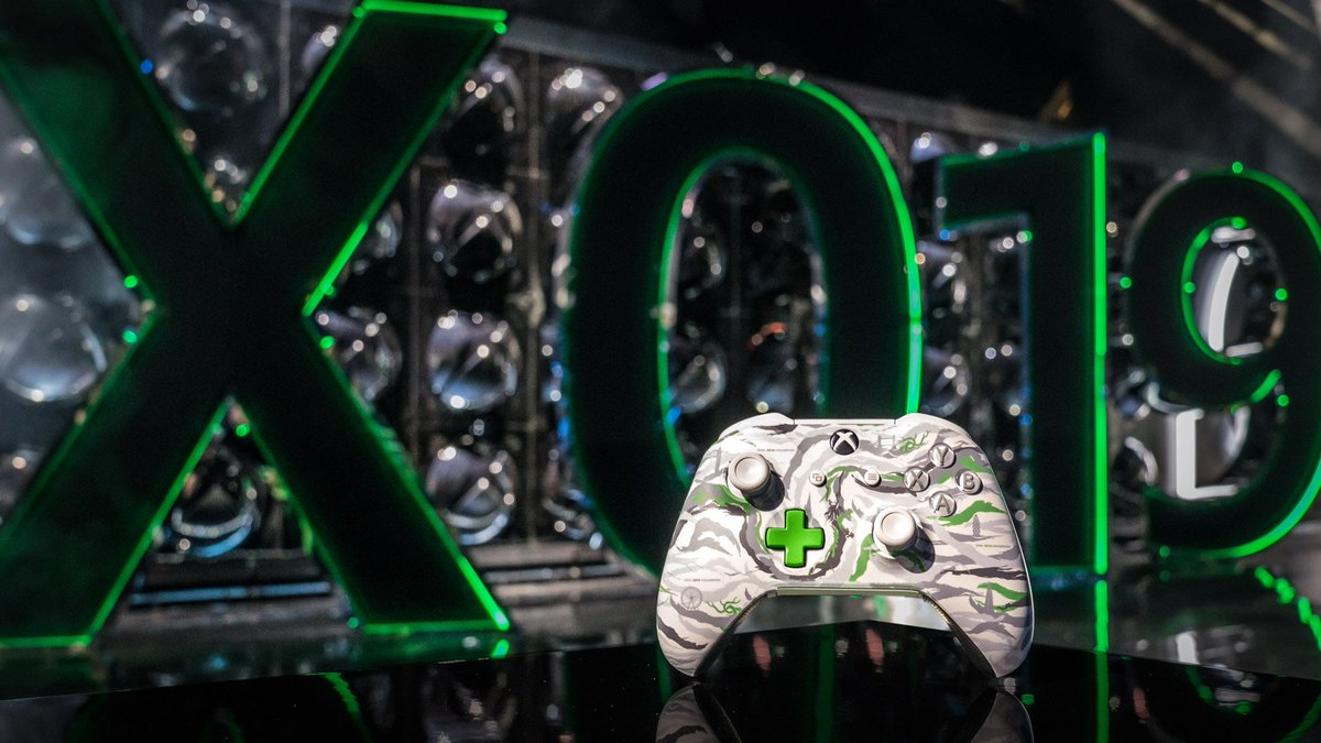 The DPM X019 Exclusive Controller stands upright in front of a black and green version of the X019 logo.