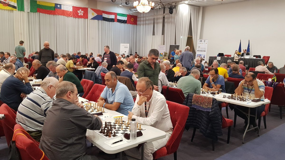 test Twitter Media - The sixth round of the FIDE World Senior Championships is being played today.   There are no sole leaders yet and no one with a perfect score - the lineups are solid and strong this year.   Results and standings: https://t.co/DHxR9hJHfn  #WSCC #SeniorChess #Chess https://t.co/SXbGU4Pnt7