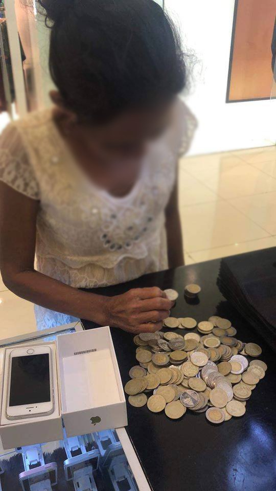 A MOTHER'S LOVEA cellphone store in Lapu-Lapu City shared a touching story of a mother who used all her savings, most of them came in coins, to buy her daughter her first-ever cellphone. (Photos courtesy of K & L Marketing)