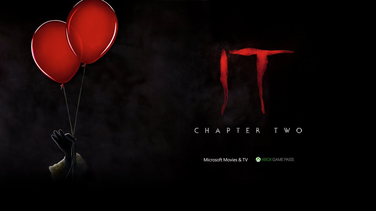 A dimly lit clown hand holds two red balloons. Text Reads: IT: Chapter 2. Microsoft Movies & TV. Xbox Game Pass.
