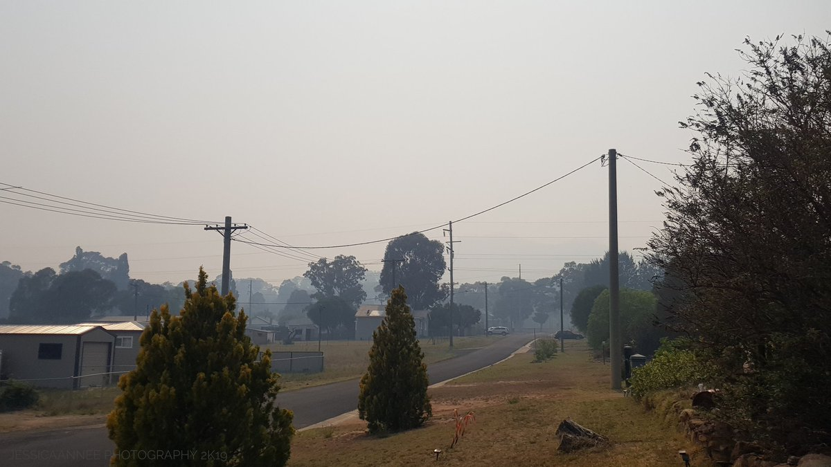 It's hard to breathe out here, you can usually see the mountains. You can only just see them in the second photo.  #RFS  #AUSTRALIAFIRES #bushfires #bushfiresNSW #NSWbushfires