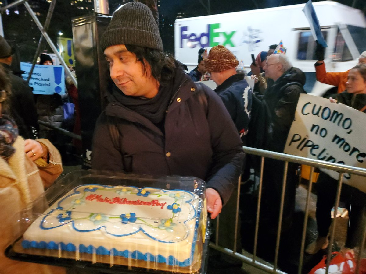 Protesters sent a message to the New York governor on a birthday cake: Make billionaires pay
