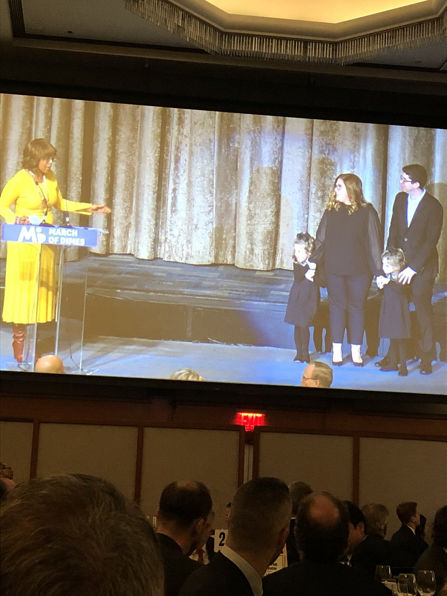 Gale King with the Guzinski Family who spoke of their experience with premature twins, and how @MarchOfDimesNY has helped their family. #SportsLuncheonNY #GivingTuesday