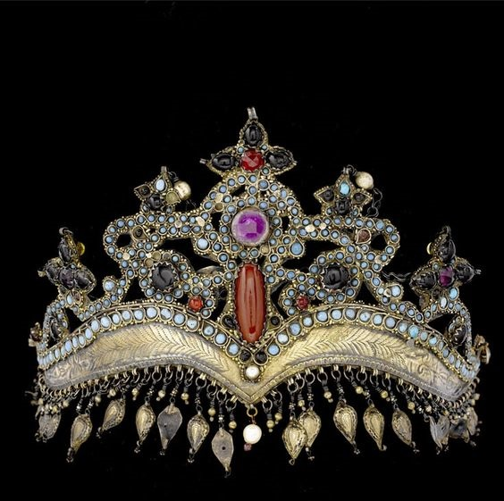 Uzbekistan, Samarkand. Metal bridal crown, parcel gilt copper inset with carnelian, turquoise, amethysts, garnet coloured stones and glass.