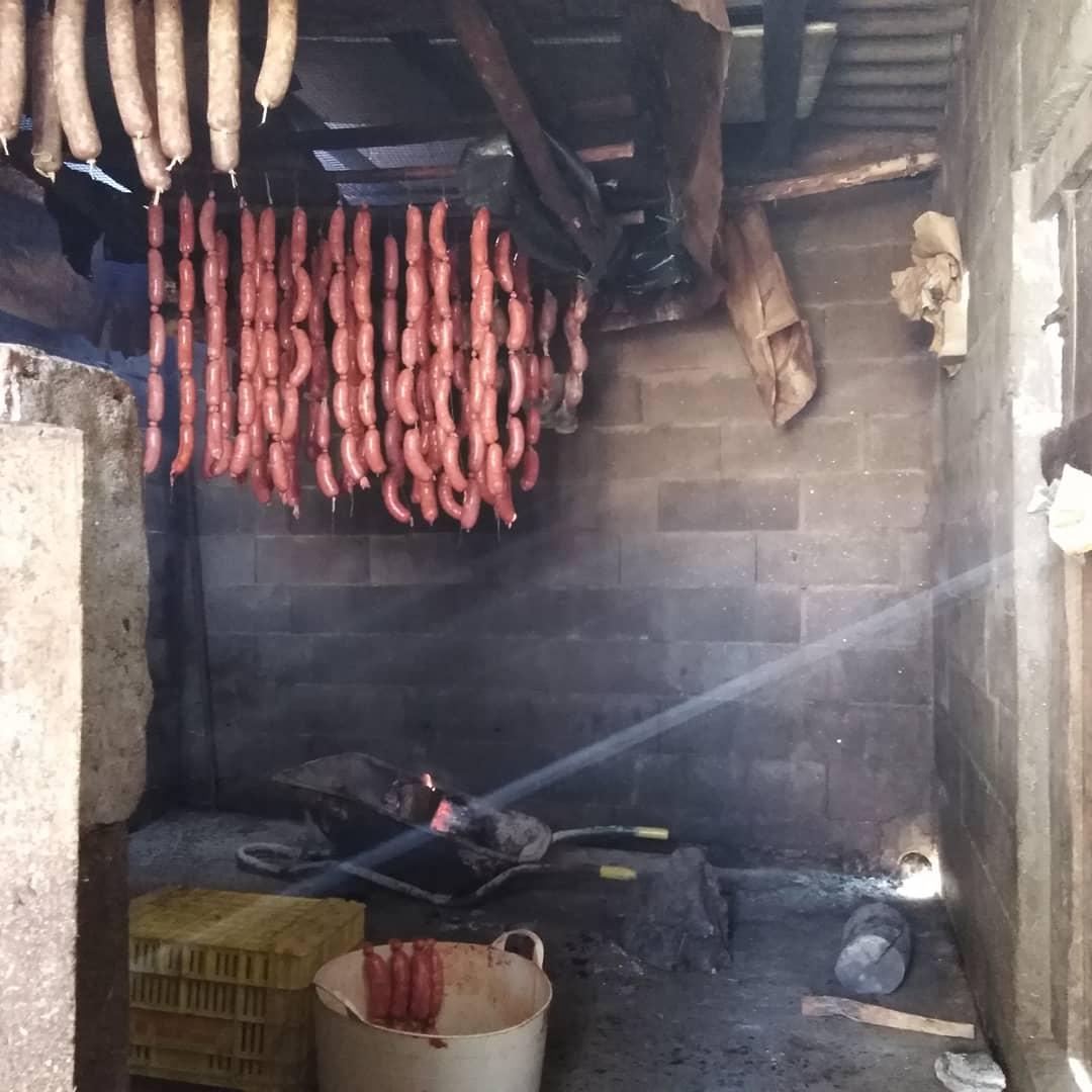 I love living here. Helping my neighbours yesterday, making chorizo.